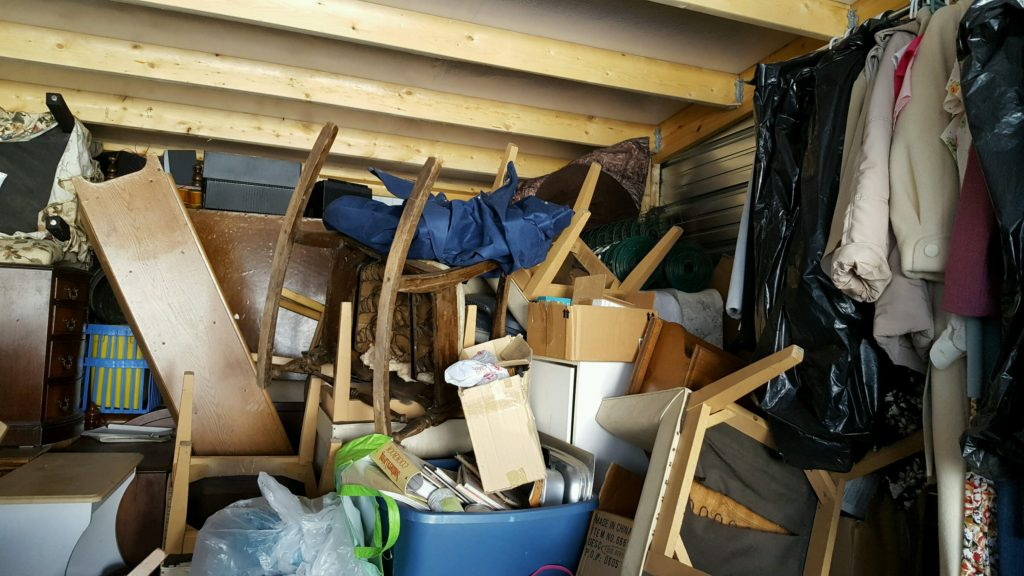 Cleaning out the unit an abandoned storage unit bought at auction waiting to be emptied