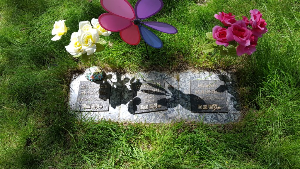 There is hope after miscarriage three babies' gravestones pinwheels flowers