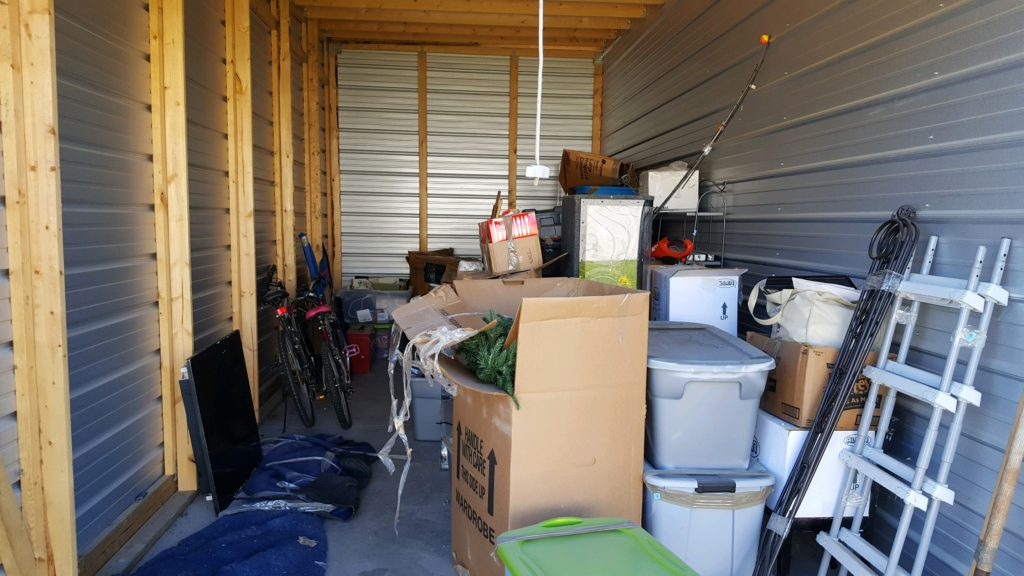 Before the bidding begins - a storage garage full of items waiting to be auctioned off