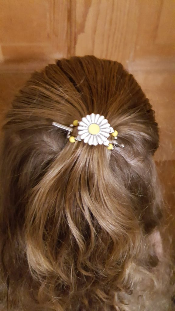 Lilla Rose Hair Accessories review image young girl curly blond hair wearing white and yellow flower Flexi Clip in back of hair