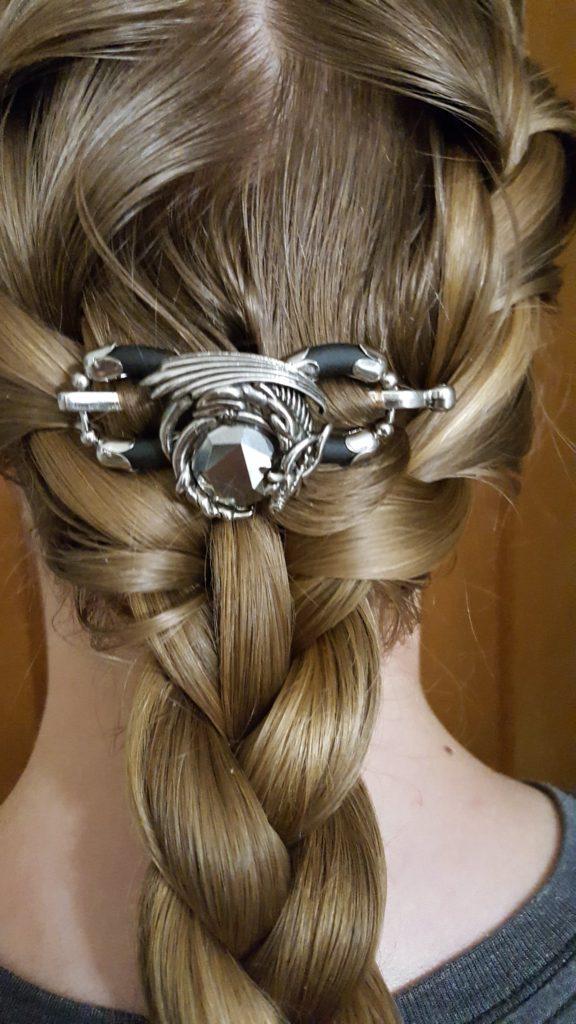 Lilla Rose Hair Accessories review image Dragon Flexi Clip photo close up of a dragon hair clip in a girls hair above a braid
