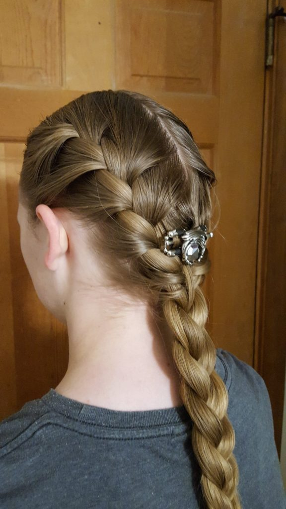 Lilla Rose Hair Accessories Review image angled side view teen girl with double braid in hair leading to single hair braid with Lilla Rose Dragon Flexi Clip