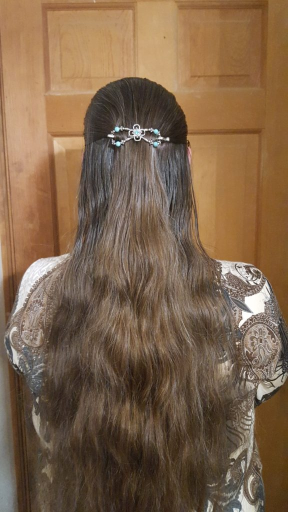 Lilla Rose Hair Accessories Product Review image woman with very long brown hair wearing teal figure eight hair clip