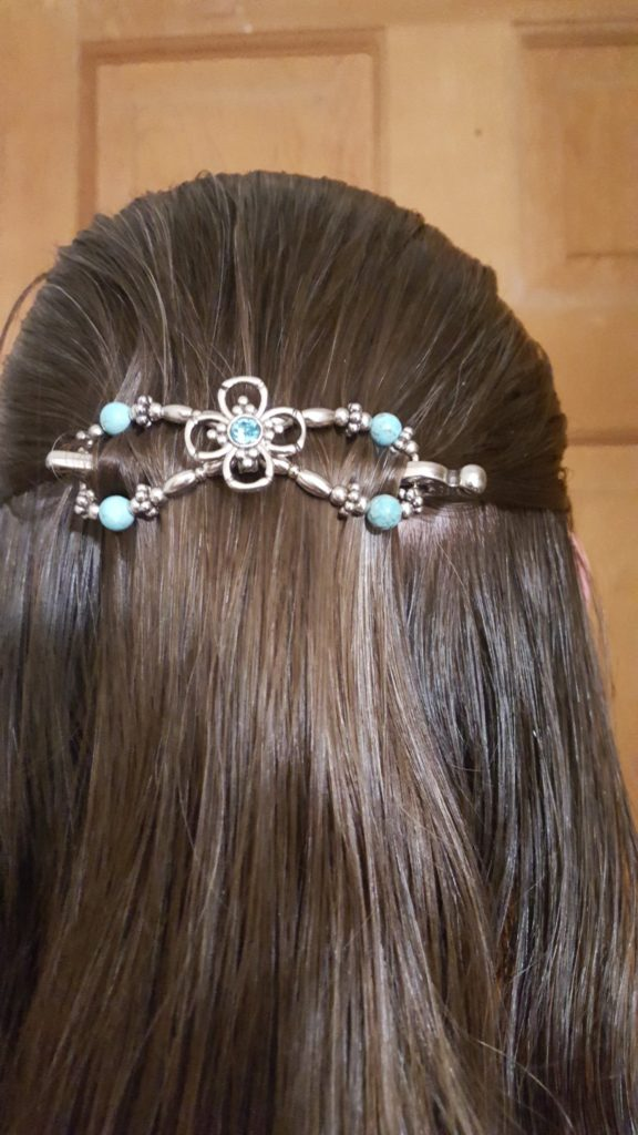 Lilla Rose Hair Accessories product review image light teal stones on silver figure eight hair clip in woman's brown hair