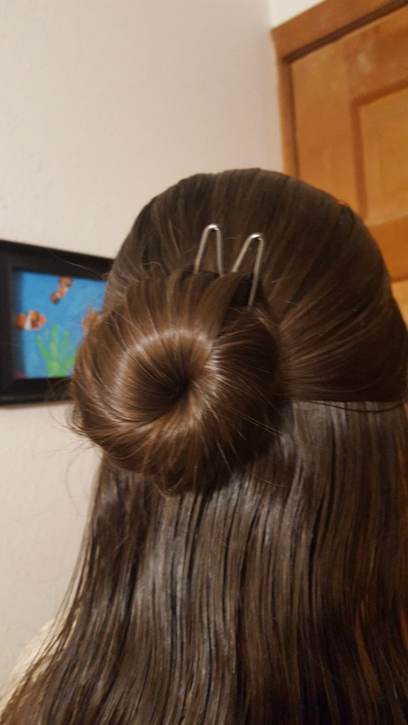 Lilla Rose Hair Accessories product review woman with brown hair wearing a bun with a Lilla Rose Fox Upin to hold bun in hair