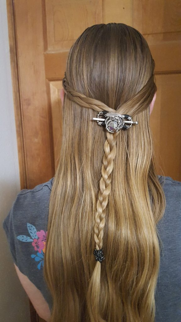 Lilla Rose Hair Acessories review image dragon hair clip above a braid on a long haired teenage girl