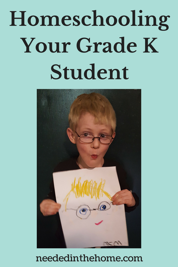 Homeschooling Your Grade K Student boy with glasses holding up his self portrait neededinthehome