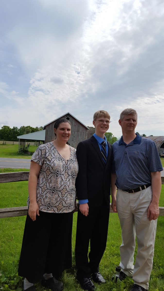 Day In the Life of a large family mom mom dad and teen son with barn in background