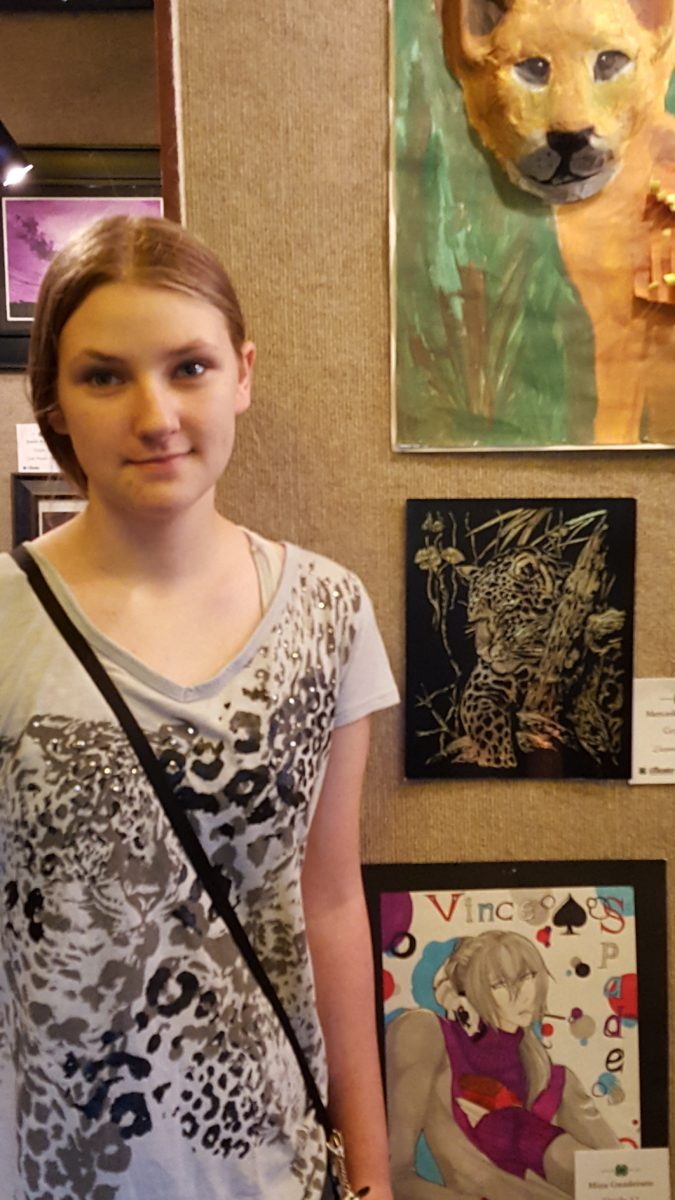 A Day In The Life of a busy mom of seven children a teen girl standing next to her art exhibit of a cheetah scratch drawing