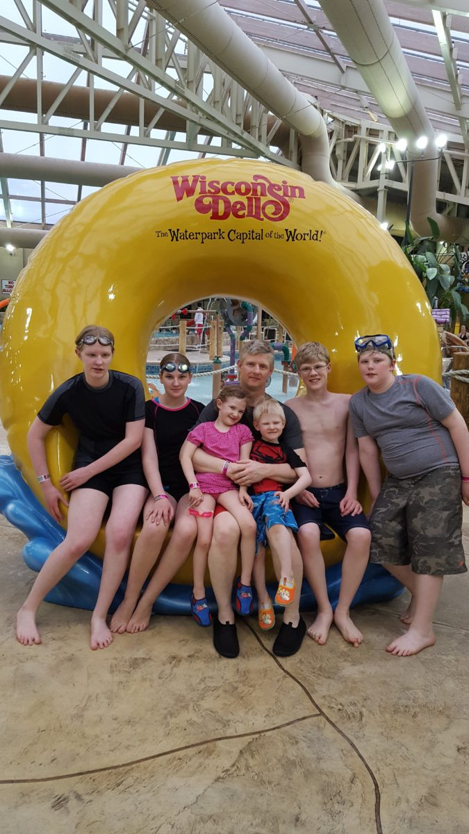 Large family vacation large family posing for a picture at an indoor water park Wisconsin Dells