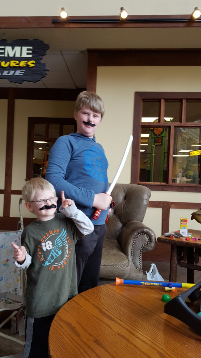 Large Family Vacation two boys wearing mustaches large family vacation arcade winnings