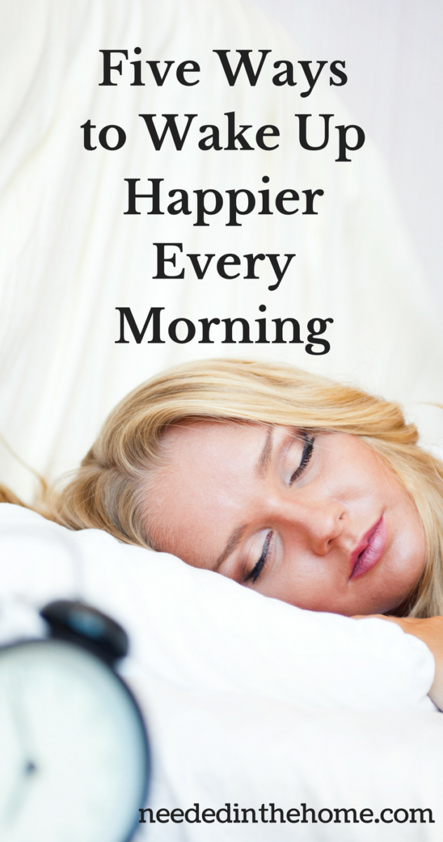 woman sleeping pillow alarm clock Five Ways to Wake Up Happier Every Morning