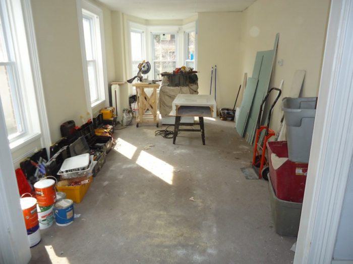 home renovation paint cans living room remodel consider true cost