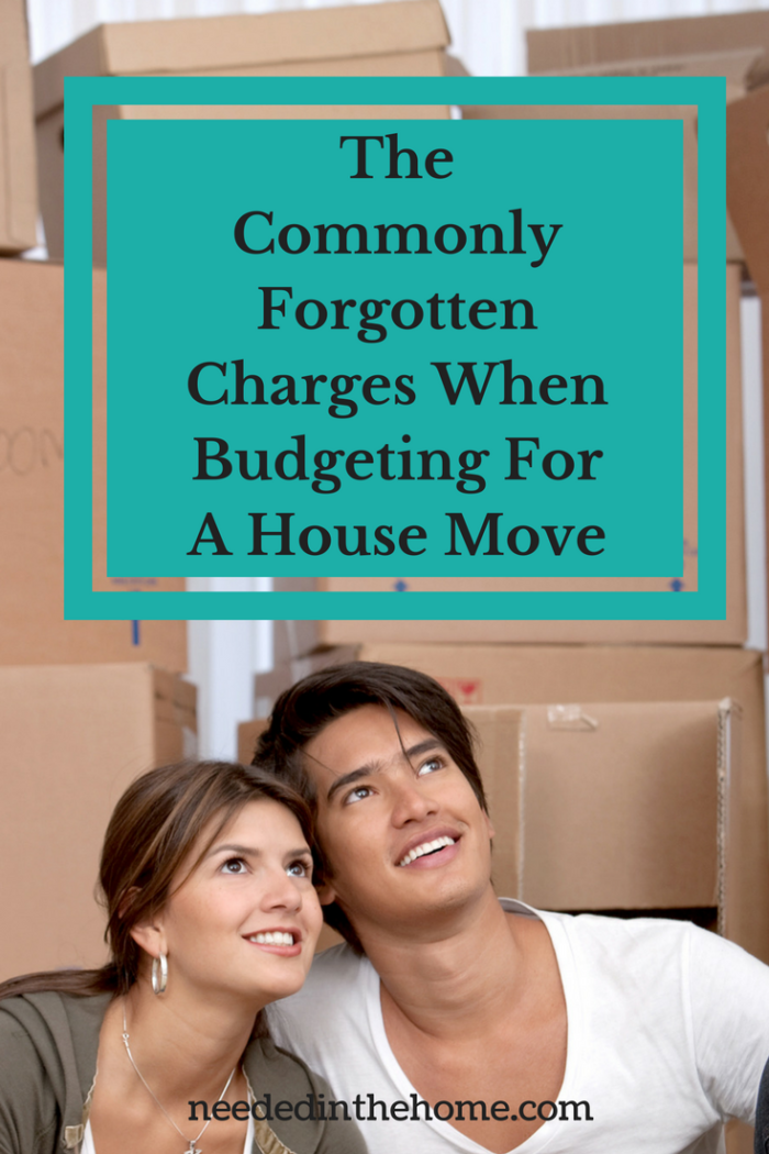 woman and man with moving boxes planning budgeting for a house move moving