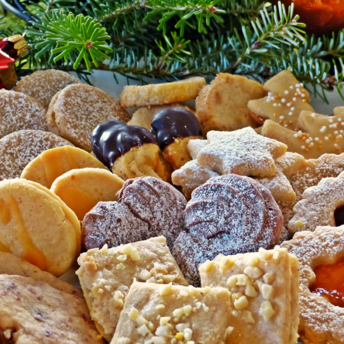 Christmas cookies diplay on a tray or plate with greenery junk food