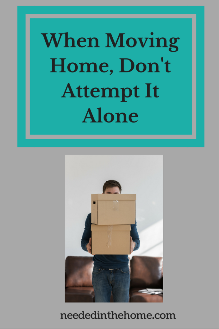 man carrying and moving two boxes with couch When Moving Home, Don't Attempt It Alone