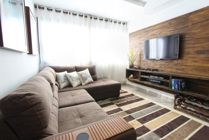 big couch sofa living room scene window tv carpet think about Downsizing