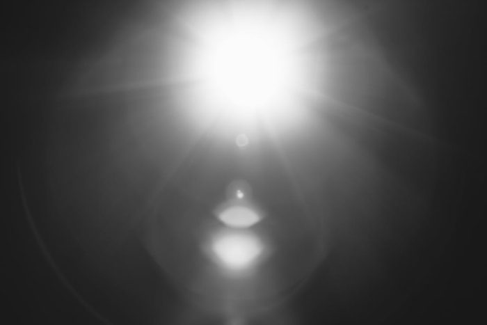 light from flashlight shining through darkness ominous home security