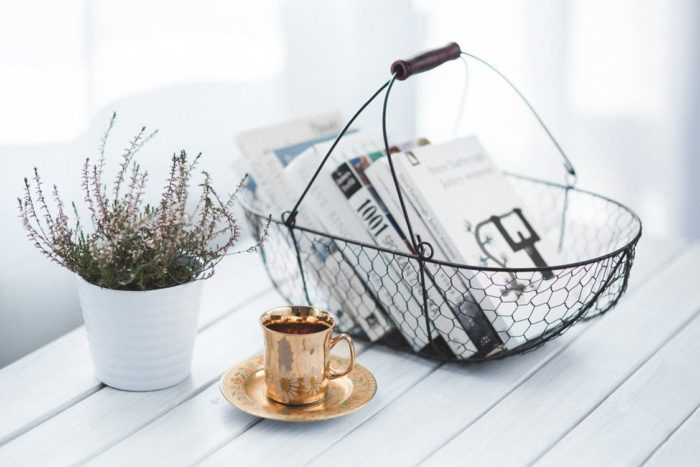 plant golden coffee cup plate wire basket of books home projects ready for the new year