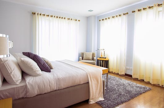 bedroom windows bed pillows lamps Five Ways to Wake Up Happier Every Morning