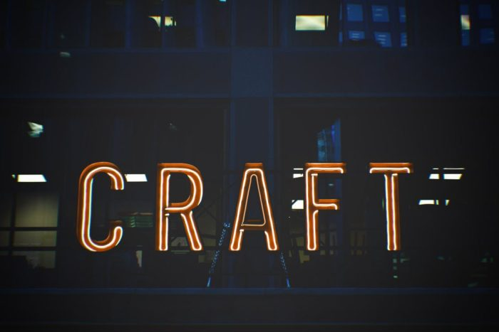 neon sign that says CRAFT Making Money From Your Homemade Crafts