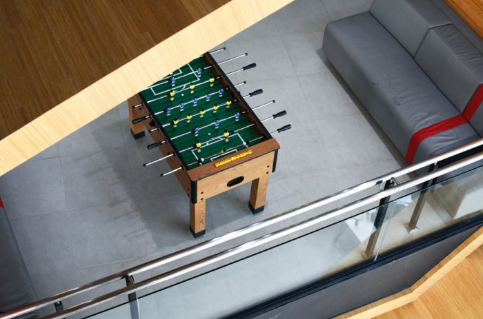 fusbol table in basement with couch basement remodel