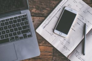 laptop keyboard notebook smart phone pen on desk family finance planning frugal living