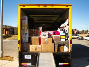 moving truck packed with boxes ready to leave forgotten charges when budgeting for a house move