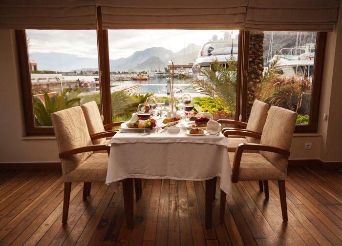 dining room chairs table window wood floors
