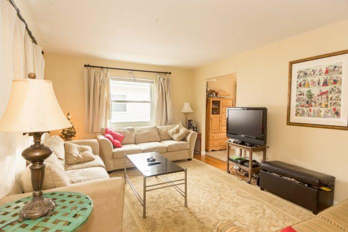 living room sofa lamp rug tv table window
