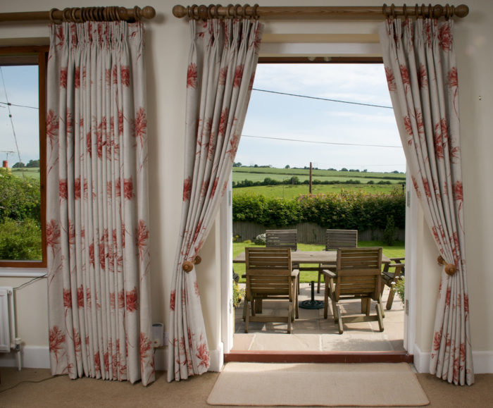 large windows with curtains Saving Money On Those Energy Bills? It Is Possible