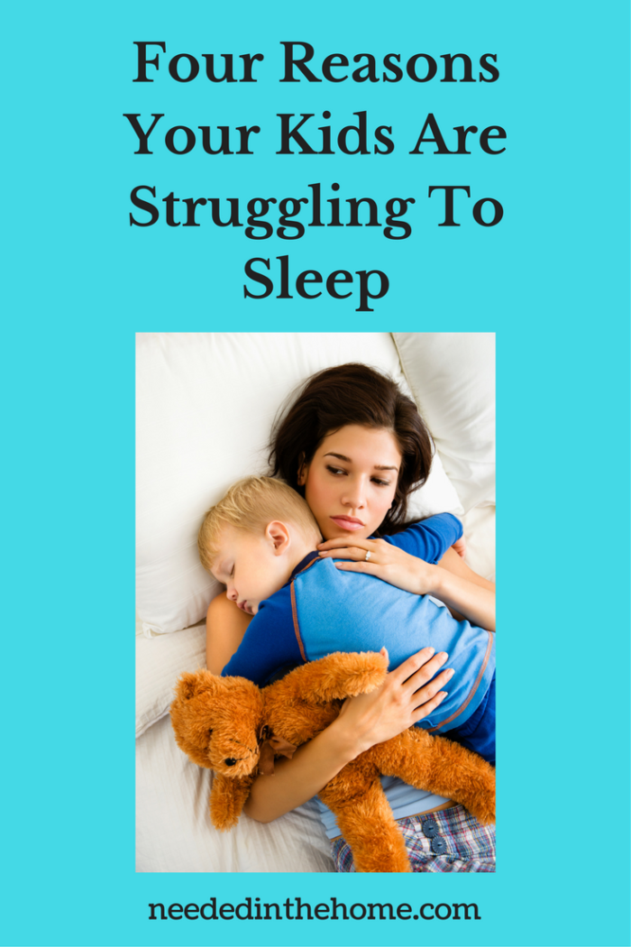 young awake dark haired mother holding sleeping toddler boy in bed with teddy bear four Reasons Your Kids Are Struggling To Sleep