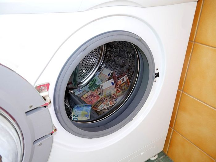 money dollar bills pounds in the dryer Simple Ways To Save Money Around The Home