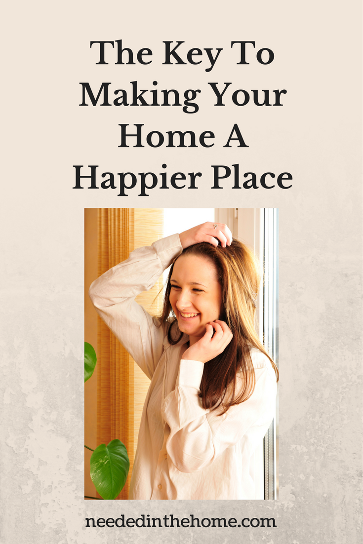 happy woman standing in front of window The Key To Making Your Home A Happier Place