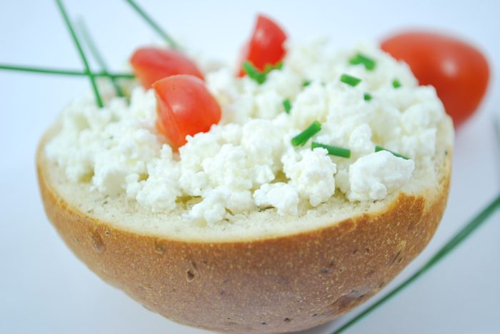 cottage cheese in a bread bowl with tomatoes and chives Save Yourself Stress By Keeping Your Kid At Their Best During School Days