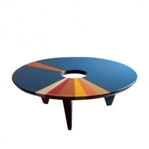 a coffee table from above by artist and designer Hagit Pincovici blue orange tan circle shape with hole in center where does design meet artistic beauty