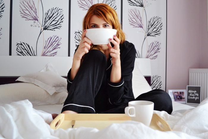 woman in bed with soup and coffee The Most Comfortable Bedroom In The World - Probably