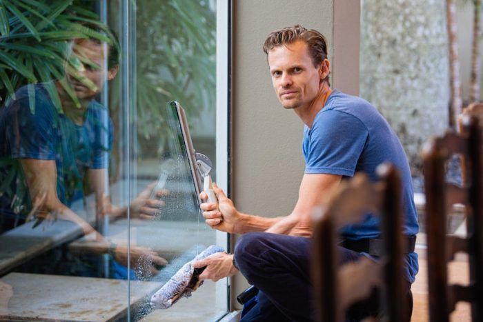man cleaning windows Spring To Your Next Spring Clean