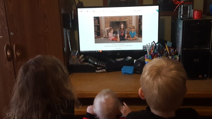 three small children watching a music video on a computer screen What to teach your 4 year old in homeschool preschool