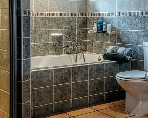 gray tile bathtub side and wall bath towels toilet Improve Your Family Bathroom Without All The Hard Work