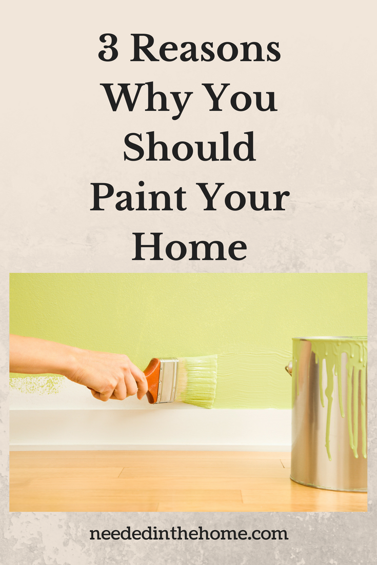 hand holding paintbrush green paint paint can wall floorboard hardwood floor 3 Reasons Why You Should Paint Your Home neededinthehome
