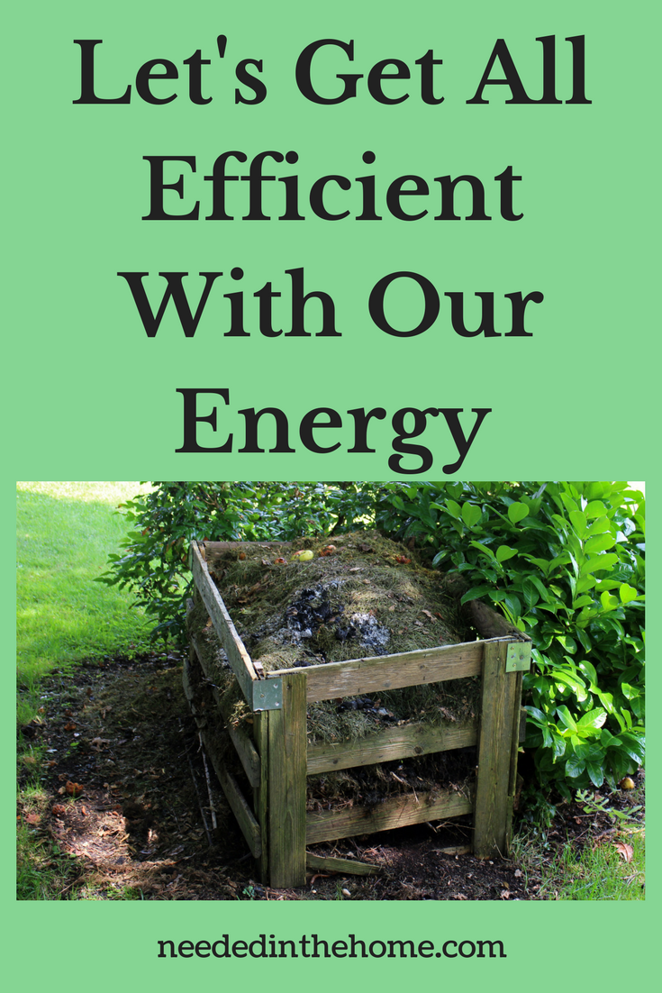 compost in a wood crate near a green bush in backyard Let's Get All Efficient With Our Energy neededinthehome.com