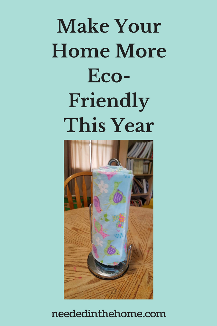reusable paper towels on a metal towel holder on dining room table chair bookcase window Make Your Home More Eco-Friendly This Year neededinthehome.com
