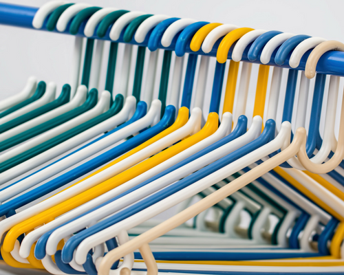 hangers on a rack in closet Preparing Your Home For Sale Before It Goes On The Market