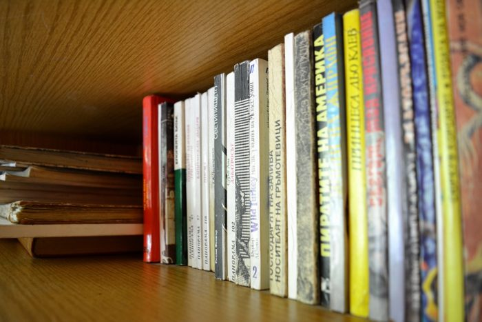 books on shelf turning guesties into besties with your guest room