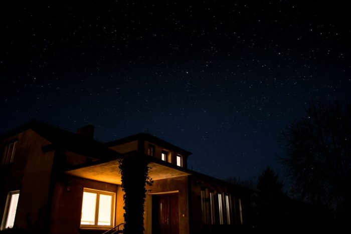 a home with lights on in the dark of night What's Going Bump In The Night In Your Home?