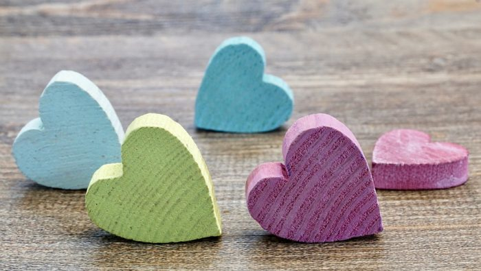 painted heart wood blocks Turning Guesties Into Besties With Your Guest Room