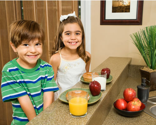 boy and girl sitting at high counter eating a snack designing your home to make it an amazing entertaining space