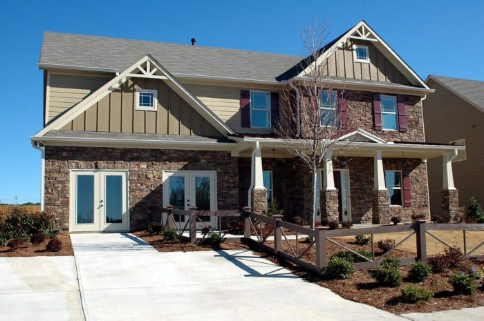 two story brick and siding home for sale no garage glass doors driveway