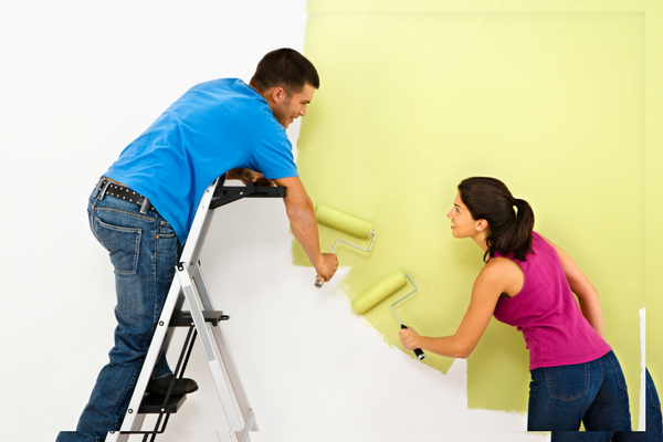 man on ladder woman standing with paint roller painting wall green smart ways to upgrade your home